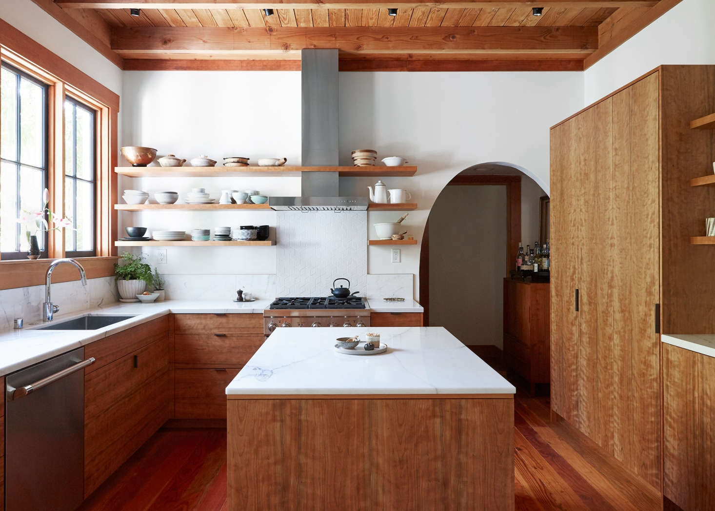 A floor-to-ceiling armoire-like cabinet adds height and additional storage in a renovated kitchen in Oakland (see more at Kitchen of the Week: Aya Brackett&#8