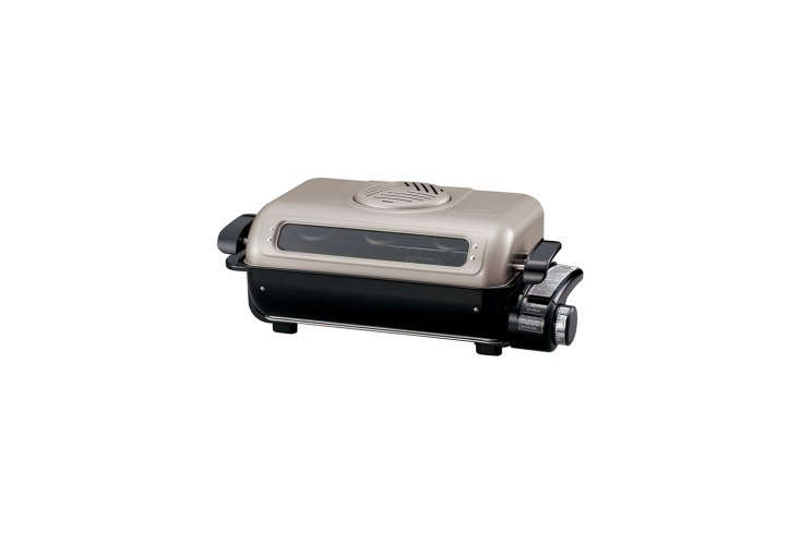 the zojirushi fish roaster is a countertop equivalent to the fish roasting draw 18