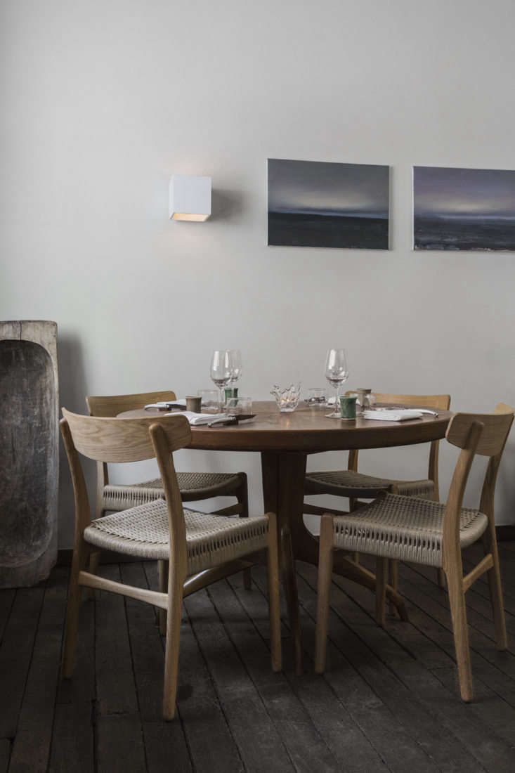 For some texture (and to break up the wood), the chairs in the dining room have woven seats. We also like the way the restauranteurs leaned an old wooden baking bowl against the wall, more sculptural than functional.