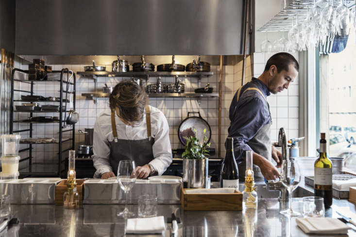 Inside the small restaurant, most of the cooking takes place in the efficient little space behind the bar (there&#8