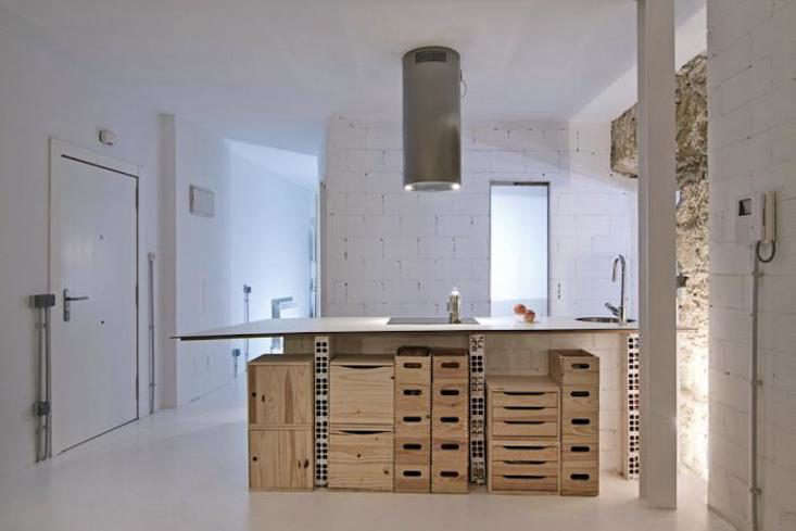 a series of plywood boxes, drawers, and crates placed under the kitchen counter 9