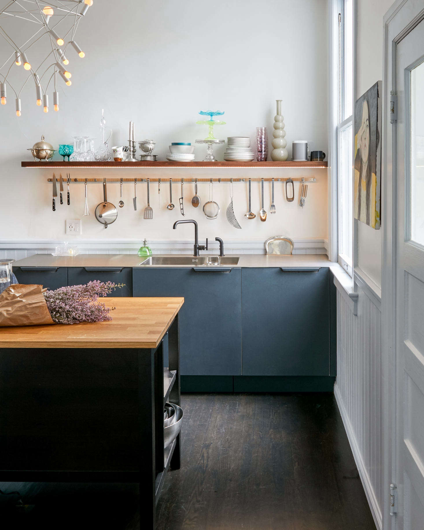 The Orbit Light is from Townsend Design and ships flat. The shelf over the sink is stained walnut with a strip of LED lights underneath. The floor is oak with a dark stain; &#8