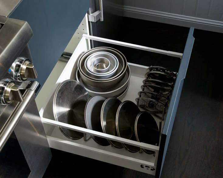 amy keeps her pot lids neatly organized in a deep drawer to the right of the st 15