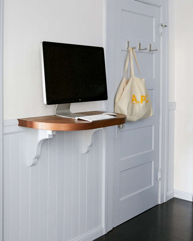 Amy and her contractor designed the stained walnut standing desk in the kitchen (&#8