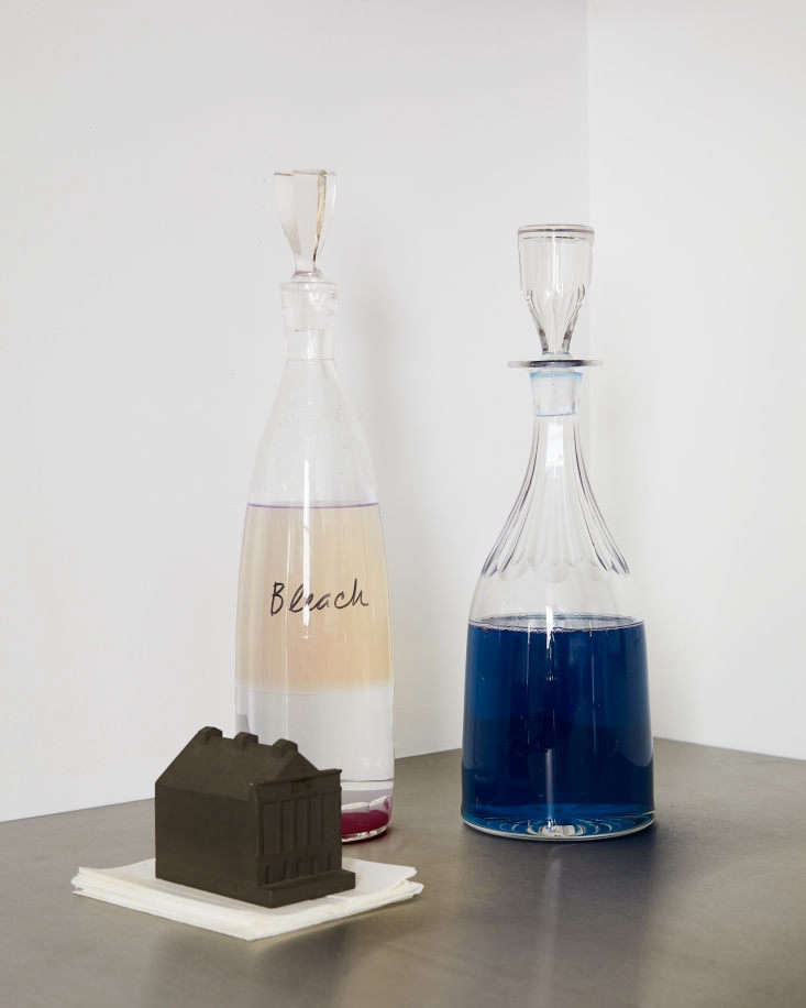 Amy keeps her laundry detergent and bleach in vintage crystal bottles. A stack of Color catchers is anchored by a mini Ford Theatre inspired by the Buildings of Disaster series by Constantin Boym and Laurene Leon Boym.