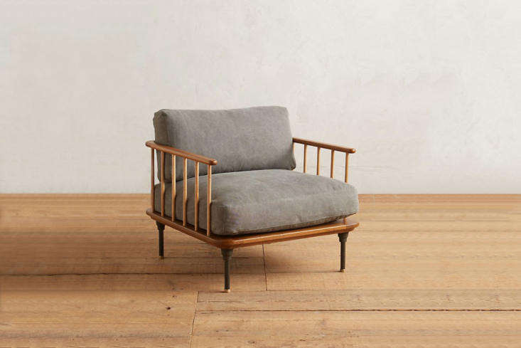The Kalmar Armchair is made with smoked oak, steel, and waxed cotton canvas; $loading=