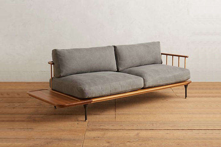 thekalmar sofa is made of smoked oak, ash, and steel and has waxed cotton can 14