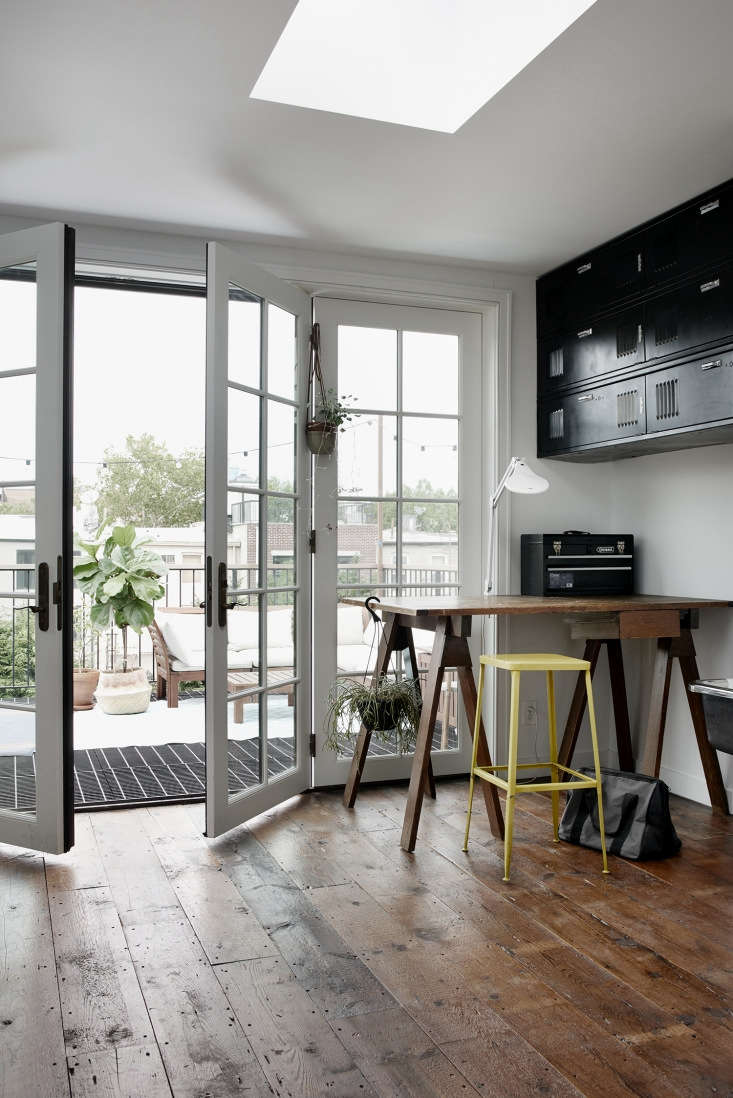 Traditional French doors lead to a north-facing balcony off of a Brooklyn townhouse. See the full project in Brooklyn Makeover: A Homey Townhouse with a Modern Garret.