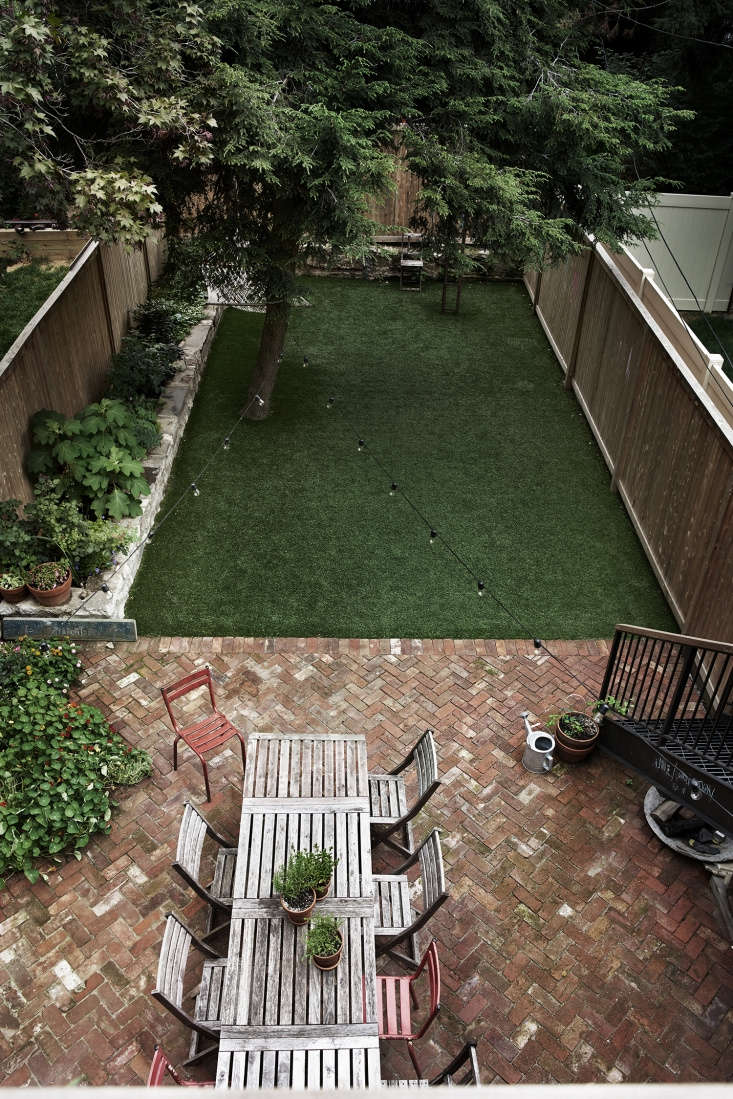 the family share their backyard with their downstairs tenants. the herringbone  26