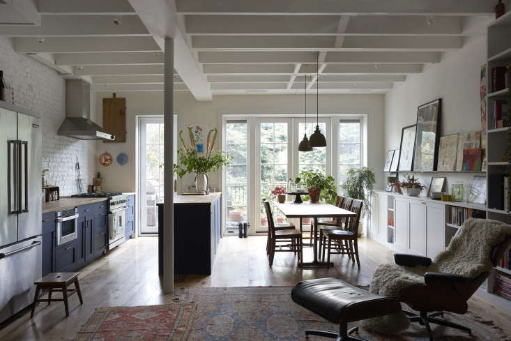 in the back of the space, the kitchen and dining area overlook the garden, newl 13