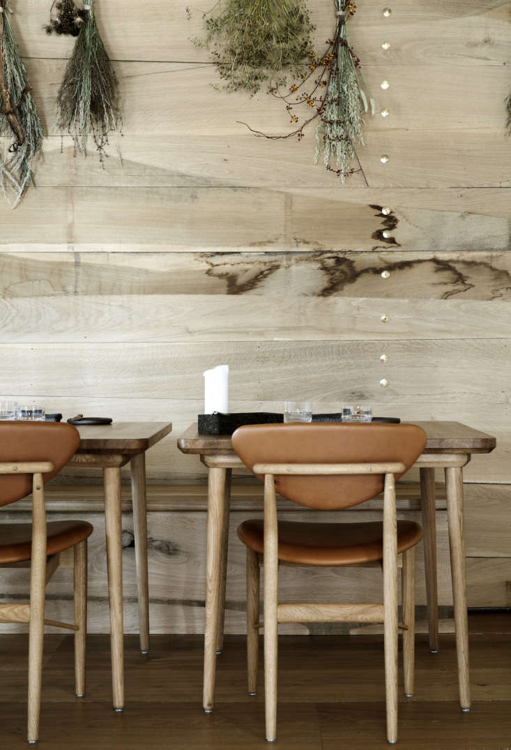 The leather and oak chairs are by Danish designer Finn Juhl.