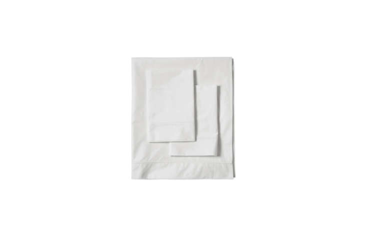Sheets at the NoMad are sourced from Bellino; a Bellino Italian Percale Shadow Stitch Sheet Set in white, seen here, is currently on sale for $loading=