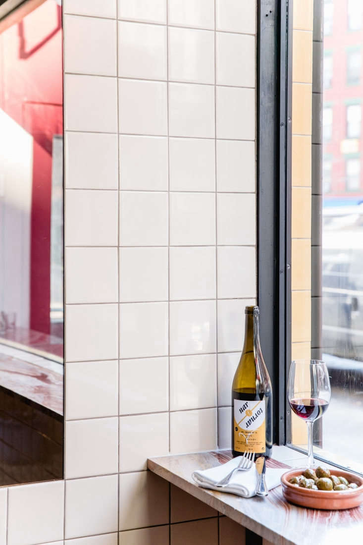 Another artful shelf/counter: The statement marble ledge in the front window of NYC wine bar Cervo&#8