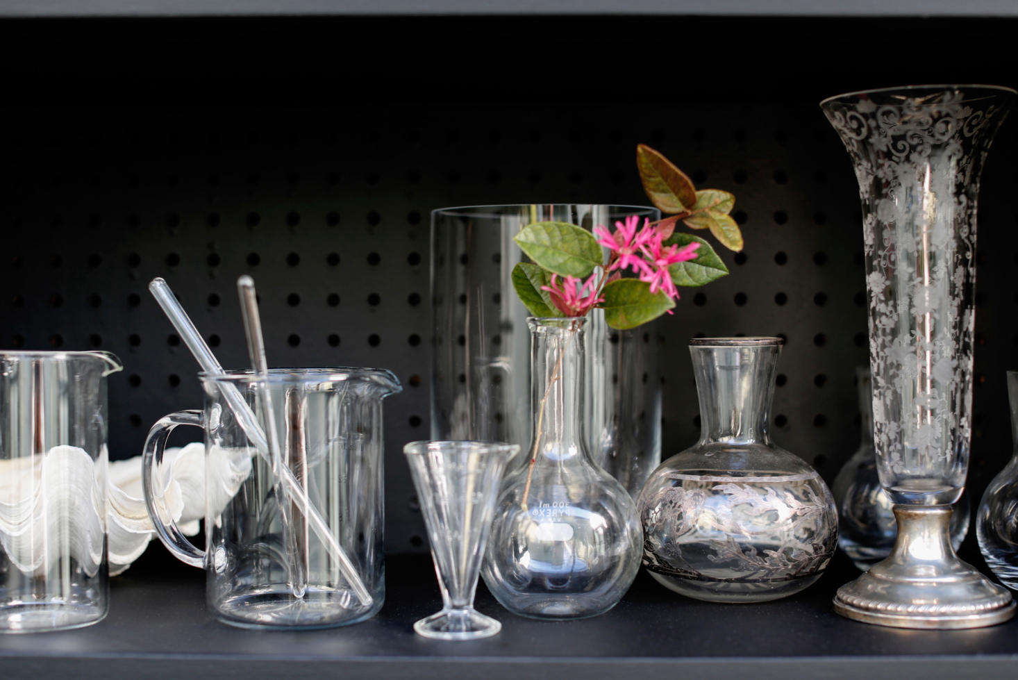A collection of vintage glassware looks lovely against the matte black backdrop.