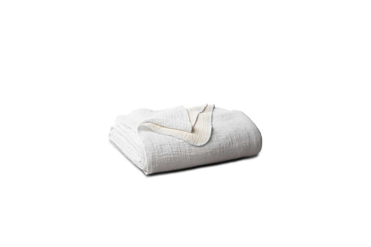 The Coyuchi Cozy Cotton Organic Blanket in white is $398 for the full/queen size at Coyuchi.