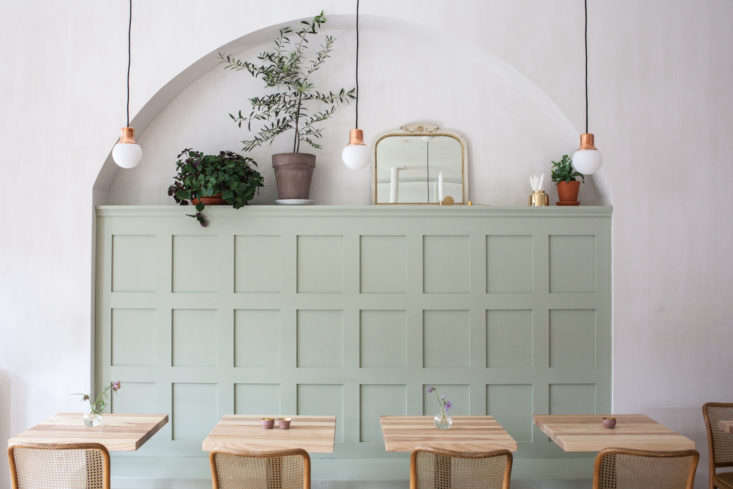 On the other wall, the team designed a wide recessed archway to offset the painted bench and add to the historic feel. &#8