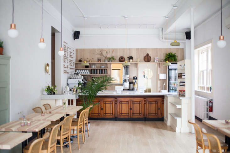 Looking toward the back of the café. The coffee counter is an antique wooden counter from the late 00s that was original to the space; the team moved it to the back and topped with marble.&#8