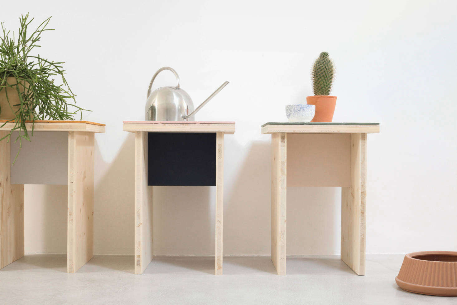 The side table has a simple plywood frame with a &#8