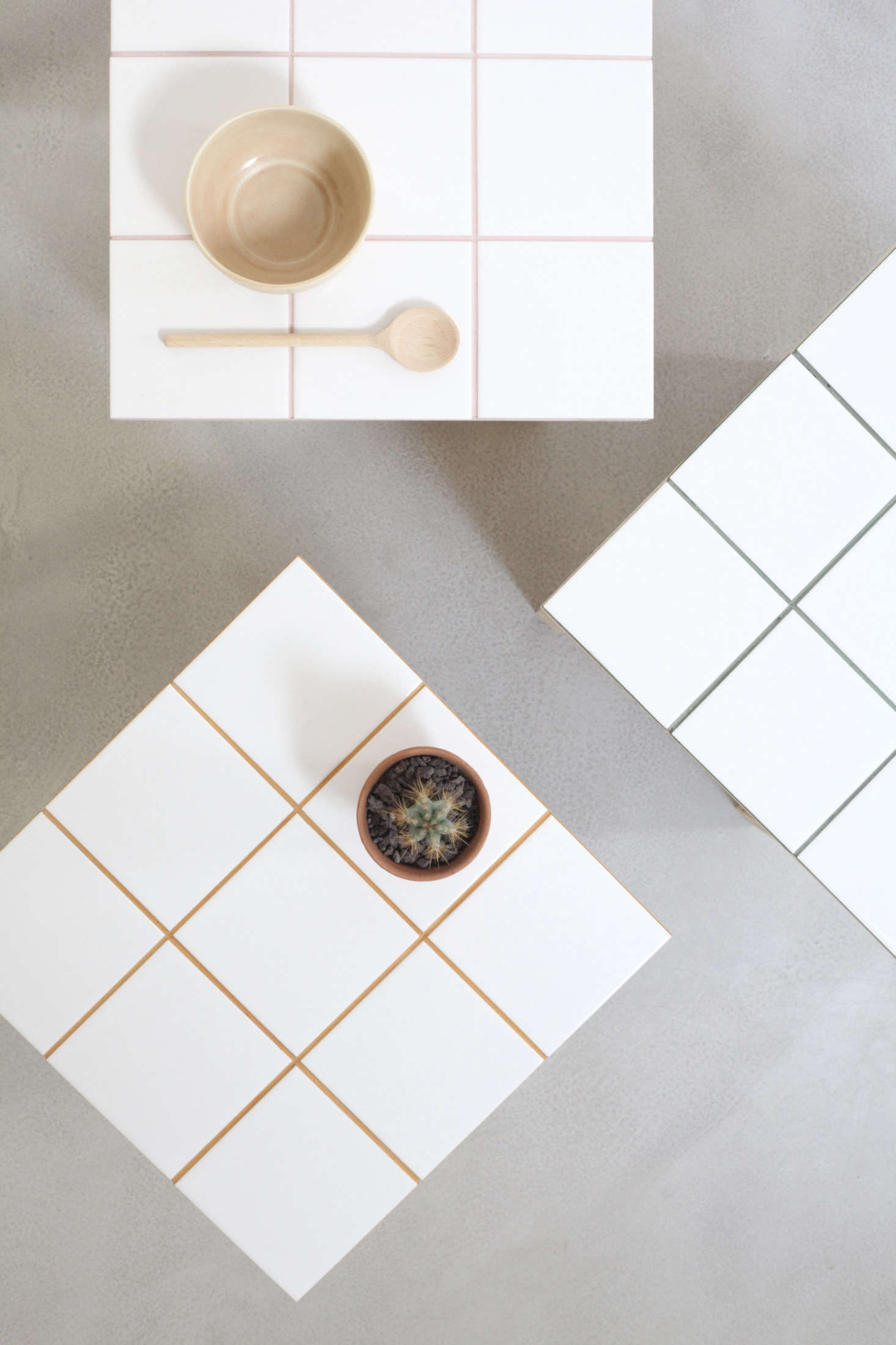 Hélène and Julien use colored pigments to create pale pink, curry yellow, and olive green grout.