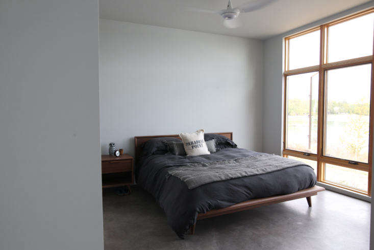 a bedroom featuring polished concrete floors with radiant heating. the windows  17