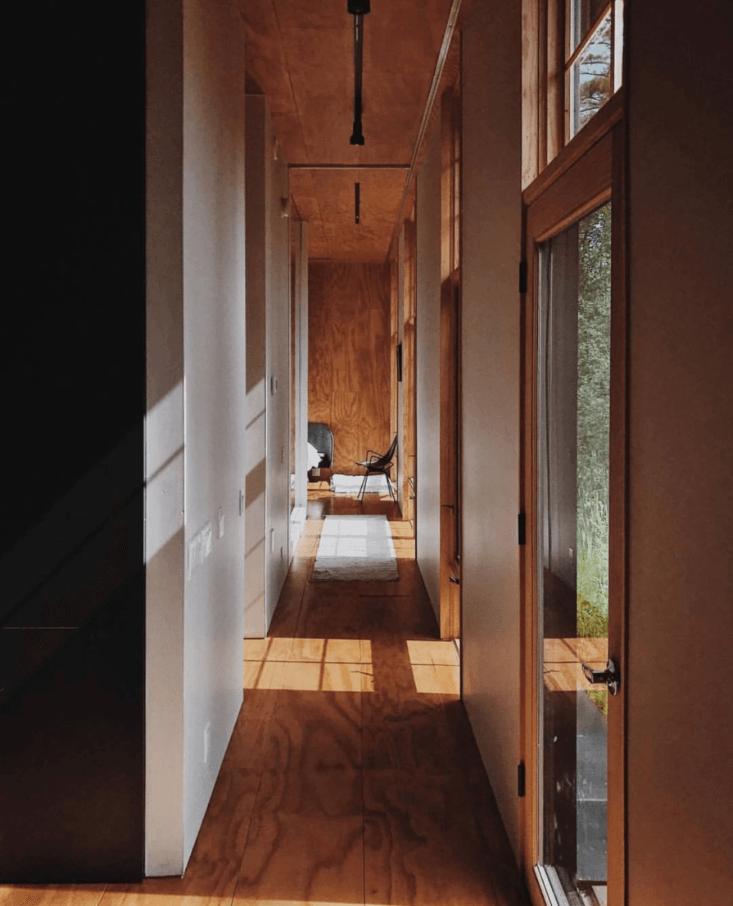 long elegant hallways are a hygge supply hallmark. clad in custom tinted plywoo 16