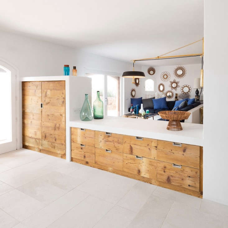 opposite the utility spaces, arens designed a built in armoire and bank of coun 18