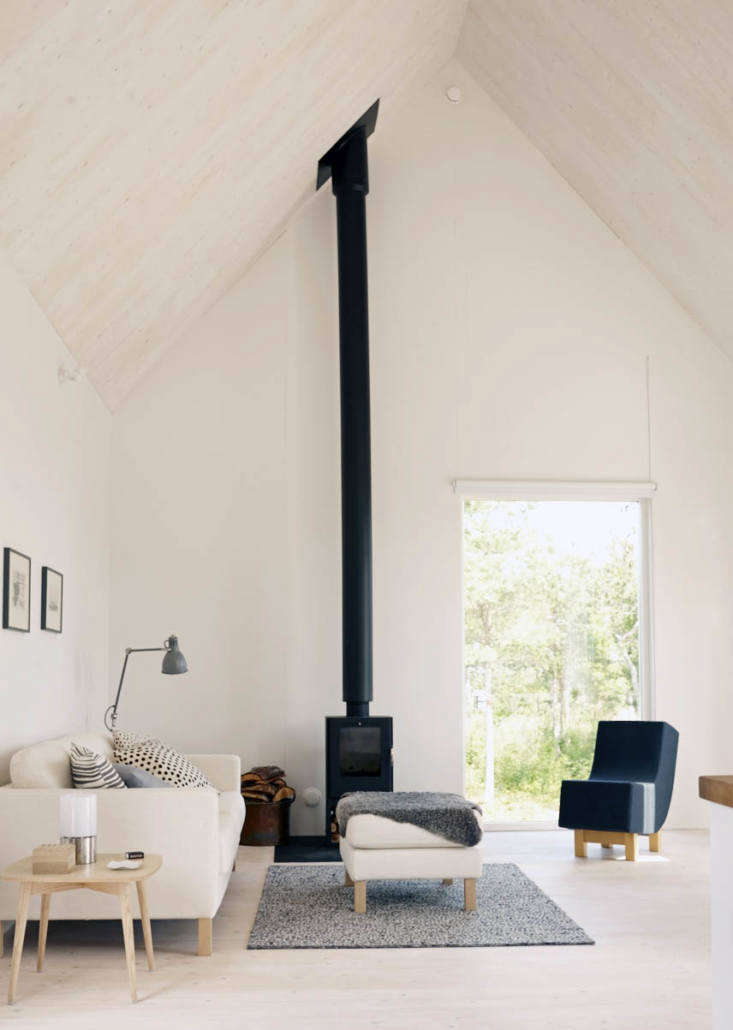 Freestanding woodstoves (see more in Easy Pieces: Freestanding Woodstoves) can be installed with certain models. The living room here is styled with Ikea classics such as the Karlstad Sofa.