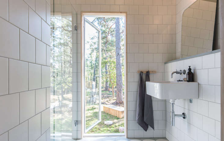 Bathrooms are designed with utilitarian tiles and classic fixtures.