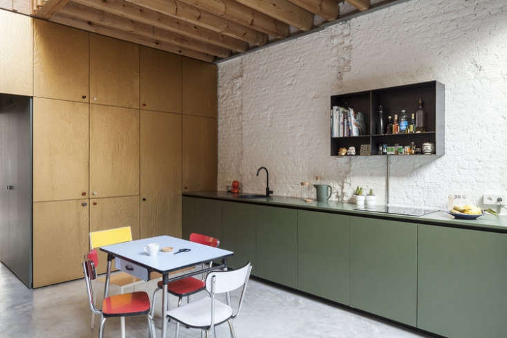 Green cabinets in a modern house in Antwerp by Belgium-basedMade Architects. Photograph byTim Van de Velde courtesy of Made Architects.