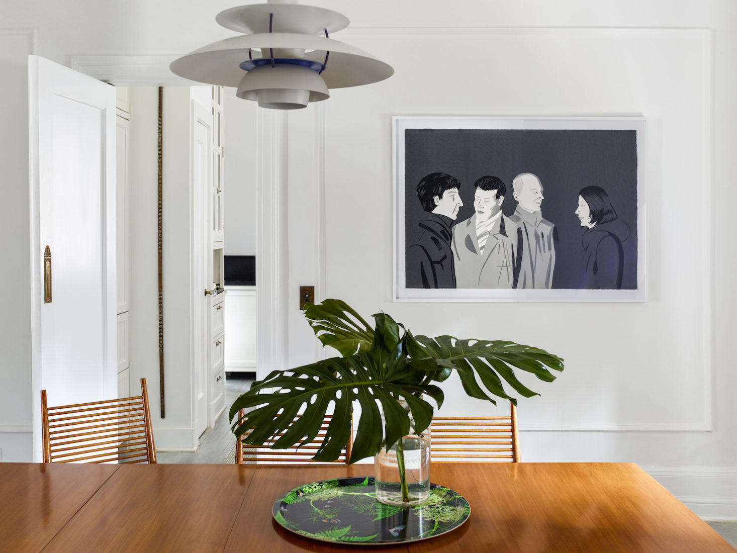 The dining set takes the spotlight in this room, but a screenprint by artist Alex Katz is also an attention-getter. On the table is a melamine-coated birch Dill Black Wood Tray by Michael Angove.