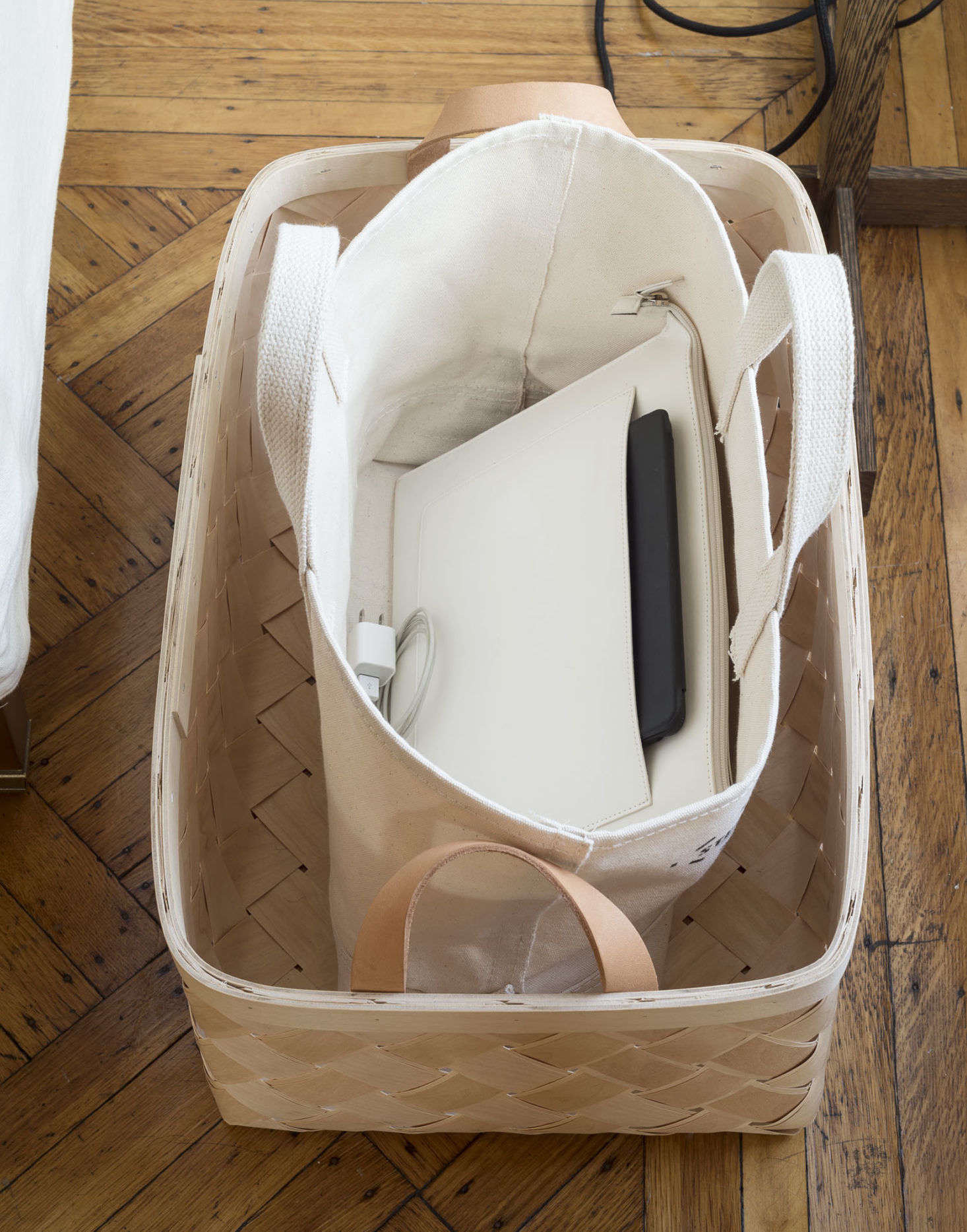An idea from The Organized Home book: an office in a bag. Slip your laptop and papers into a bag (we like a stand-up canvas version like this, but any will do); chargers can go into smaller bags inside. Tote it all to your at-home workspace in the morning, then pack it away when it&#8