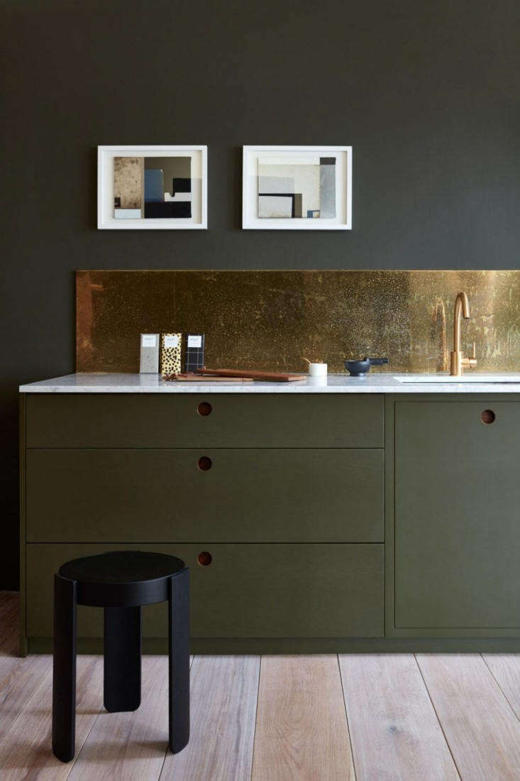 Trend Alert 10 Favorite TimeTested Dark Green Kitchens From Norfolk, England, brand Naked Kitchens, this dark green kitchen from the Ladbroke line has marble and walnut countertops with a bronze backsplash. Photograph courtesy of Naked Kitchens.
