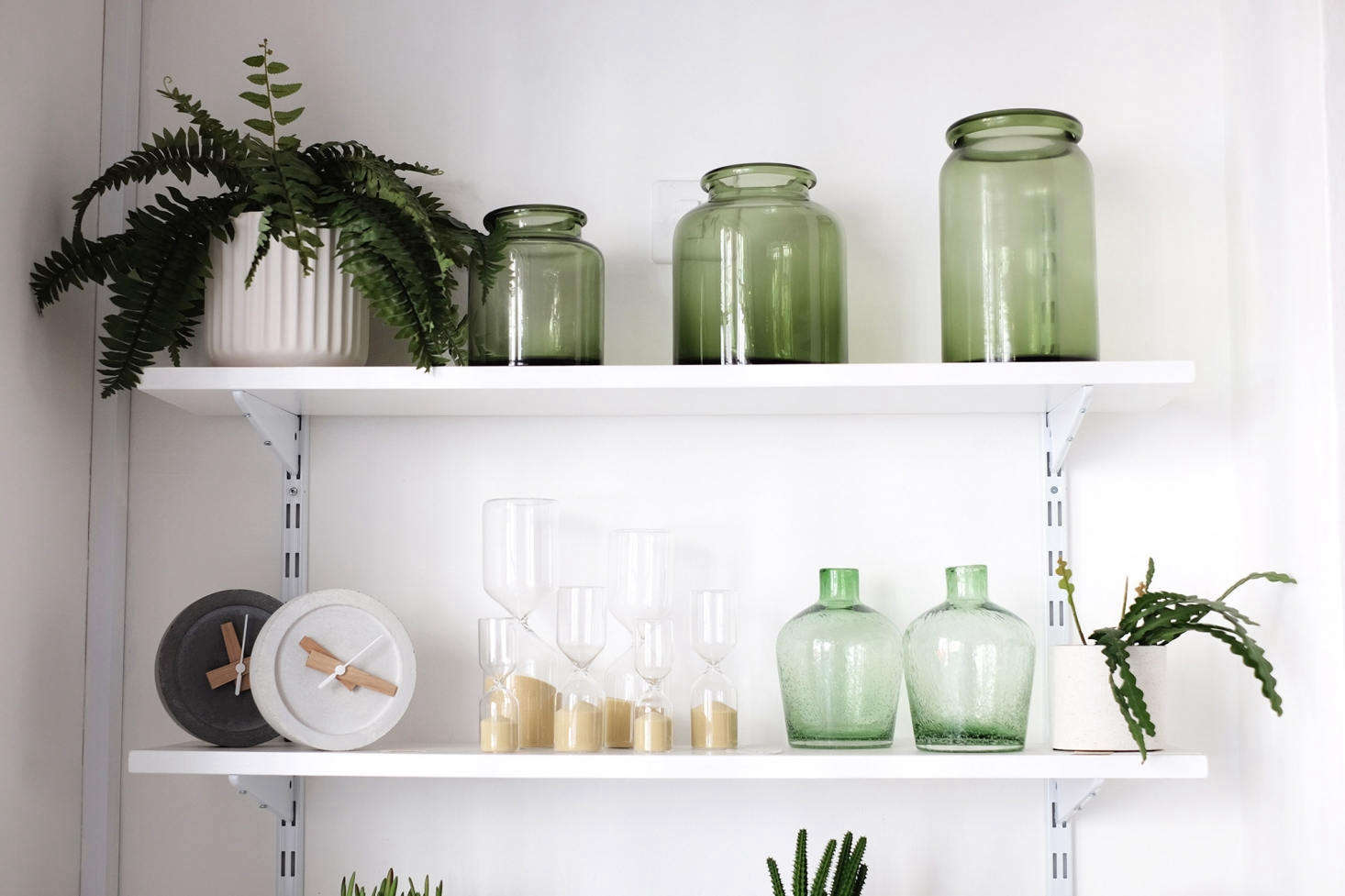 Hour Glasses (starting at £) and a green-themed vignette that includes Green Bottle Vases (£ each).