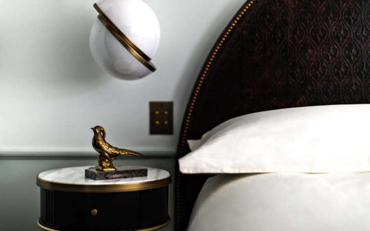Above: A stately textured headboard is byMuebles Delta; the spherical bedside lighting by Siena Design.