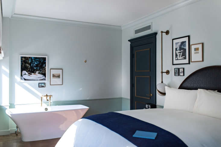A corner guest room with an en suite bath fromNoMad LA: An Iconic Hotel Debuts on the West Coast, Italian Grandeur Edition.