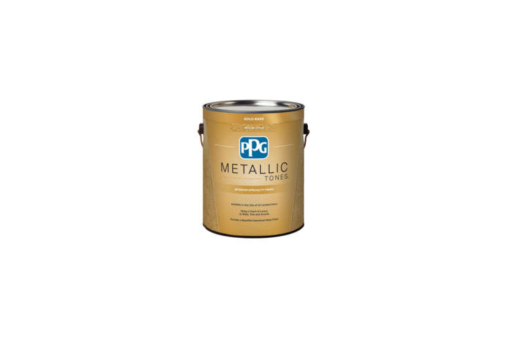 The Hague Blue door has defined molding in a custom metallic bronze patina paint. For something similar, the PPG Golden Saffron Metallic Interior Specialty Finish Paint is $47.98 per gallon at Home Depot.