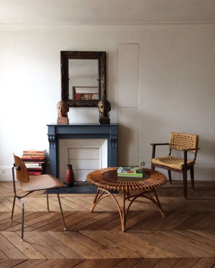 ARattan and Wood Coffee Table from the 60s paired with an Eames molded plywood dining chair and woven hemp armchair.