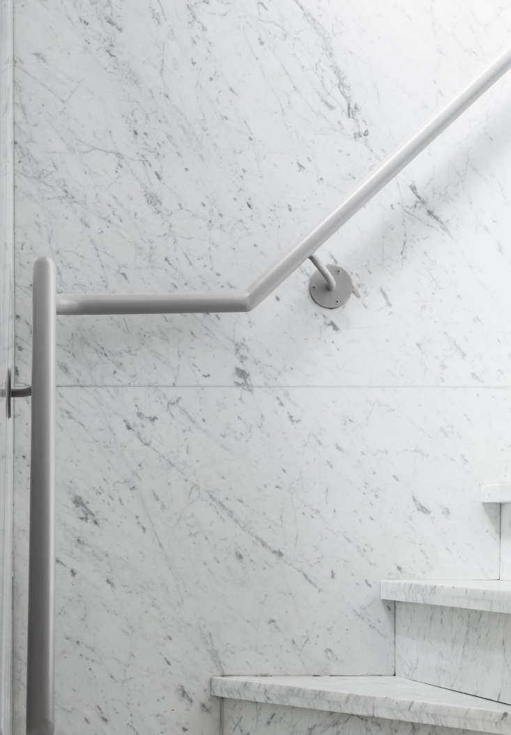Wall and stairs are clad in Calacatta marble. &#8