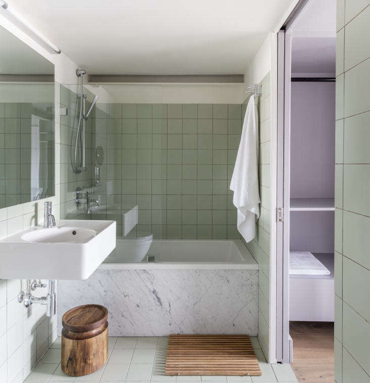 An inspired color combination in an en suite bath: celadon Mosa Global Collection Tiles alongside a lilac closet. The architects aren&#8