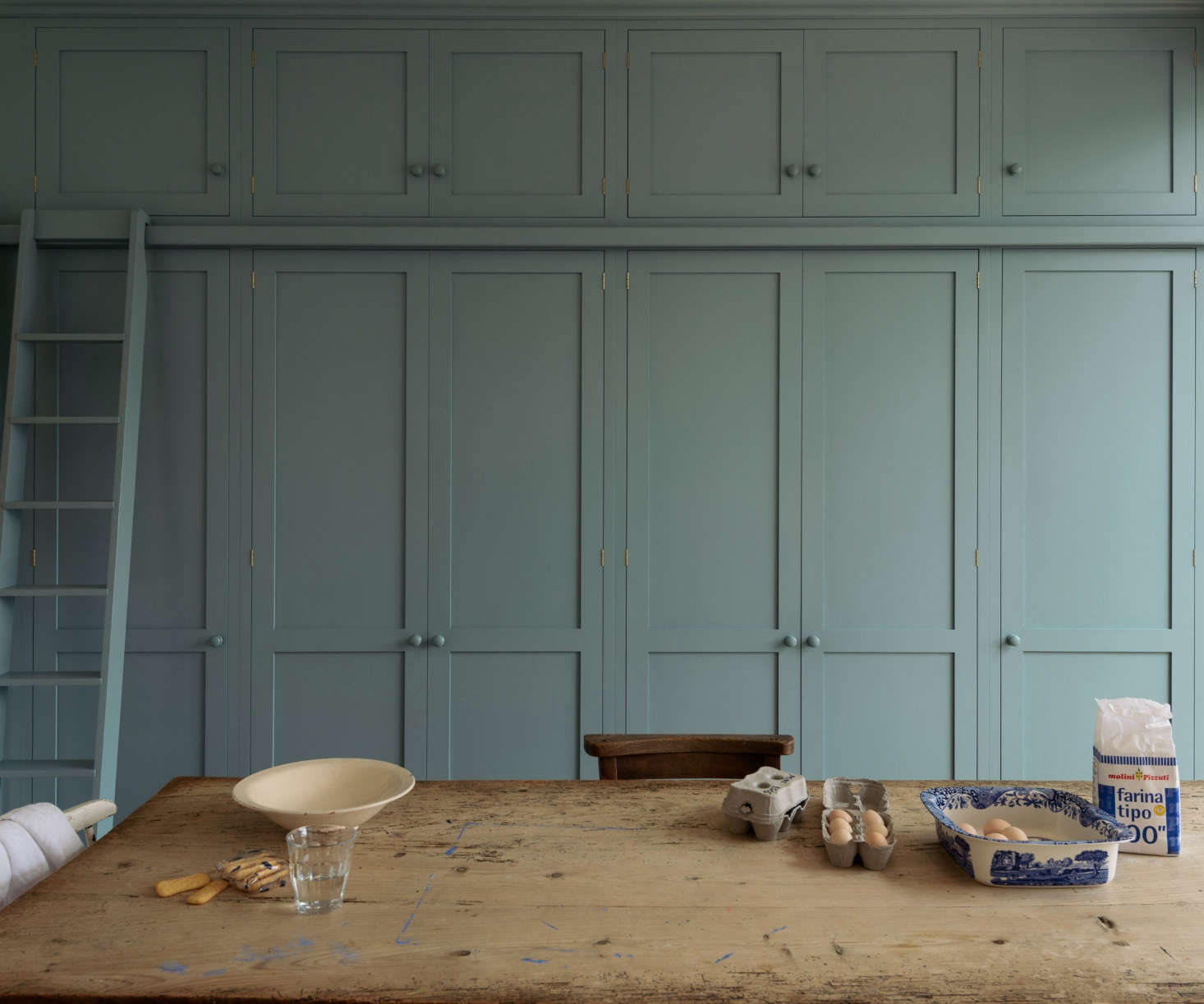 A wall of Shaker-style cabinets in a Strawberry Hill kitchenin southwest London.Photograph courtesy of deVol.