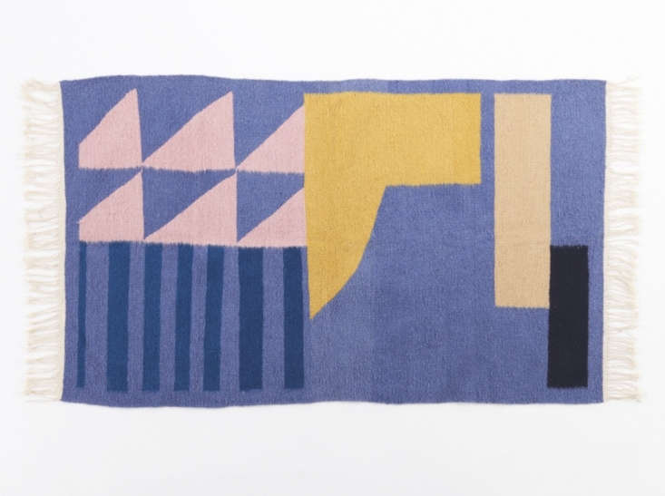 This 0 percentWool Geometric Rug applies a contemporary motif to the ancient art of weaving wool rugs by hand. The three-by-five-foot rug is $loading=