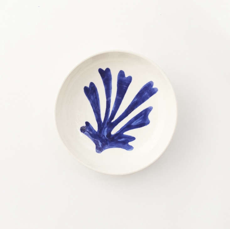 ALarge Ceramic Bowl features a hand-painted leaf motif inspired by the work of Henri Matisse. Made of clay, the bowl is shaped and glazed by hand in Nabeul, the hub of Tunisia&#8
