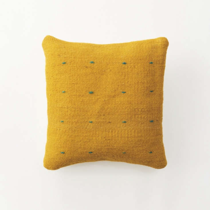 This Yellow Halfa Pillow is also a halfa/wool blend, woven by hand in turmeric-dyed yellow with small blue checks. It&#8