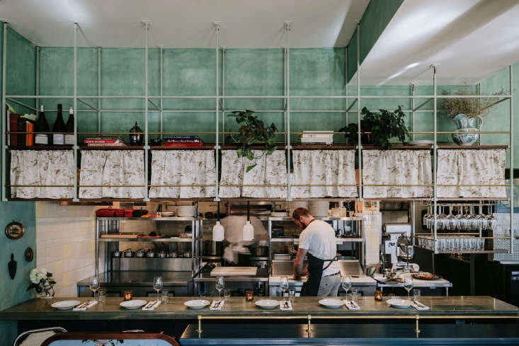 the chefs&#8\2\17; counter has above bar metal and wood storage shelves. th 22