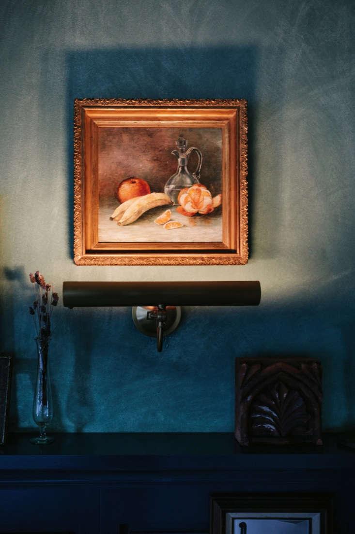 vintage paintings, lit from below. 24