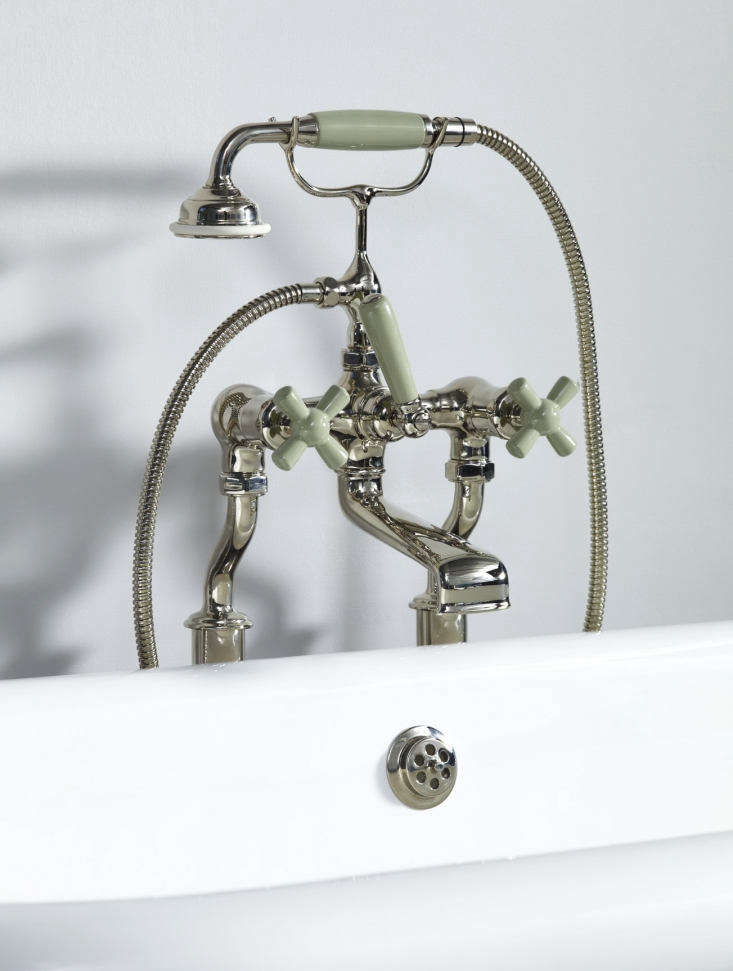 The Rockwell Bath Shower Mixer with Free Standing Legs, shown in Willow Green, pairs with freestanding bathtubs and can be ordered with colorful crossheads and handgrip; £loading=