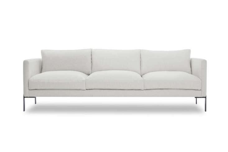 The TRNK Truss Sofa, shown in Clavicle, is made-to-order in the US and can be customized in fabric, color, and frame choices. It rings in a little above our max at $3,0 at TRNK. The sofa is also available in ivory cotton for $