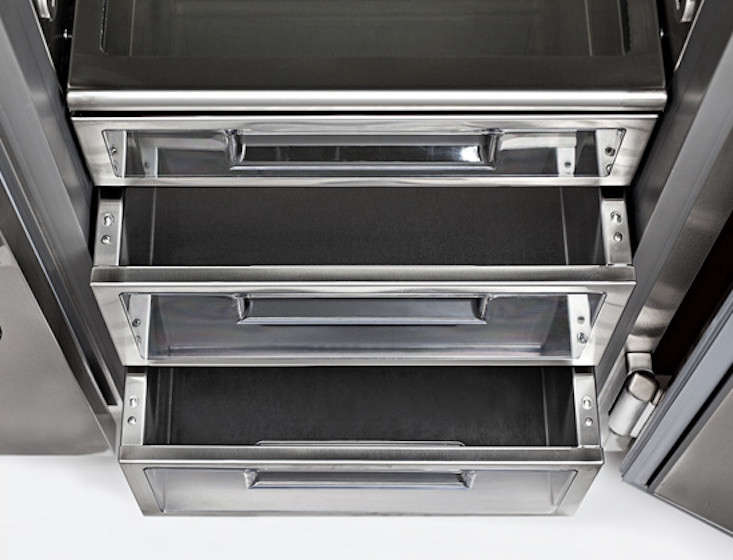 refrigerator drawers are built of glass and stainless steel and feature a soft  12