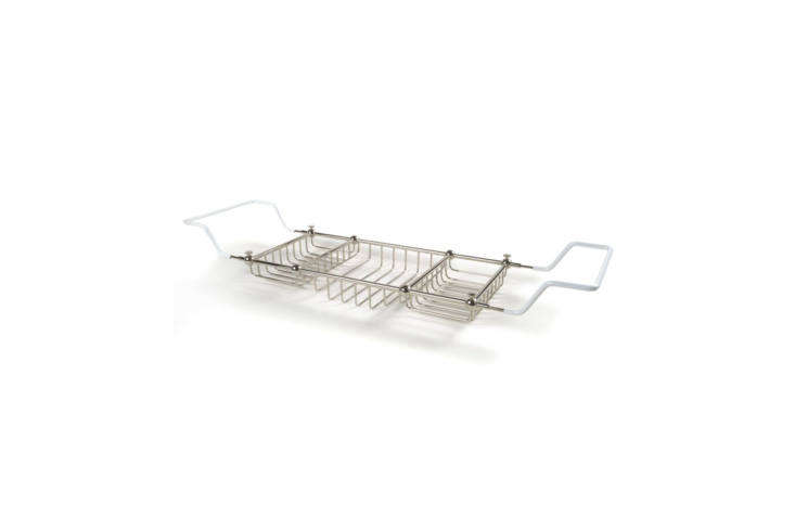 The Waterworks Crystal Tub Rack Caddy in unlacquered brass is $748 for the large size.
