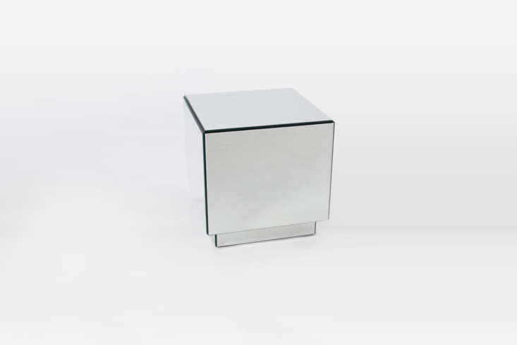 The West Elm Geo Mirror Storage Side Tableis similar to the custom mirrored tables against the windows in the Ett Hem suite. The side table is currently on sale for $9.99 at West Elm.